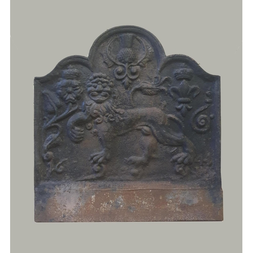 2316 - A CAST IRON FIREBACK DATED 1644. A fire back with arched top, decorated with a central lion passant ...