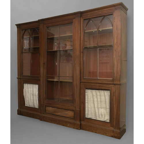2326 - A LATE GEORGE III MAHOGANY LIBRARY BOOKCASE. With a broad central door with six glass panels enclosi...
