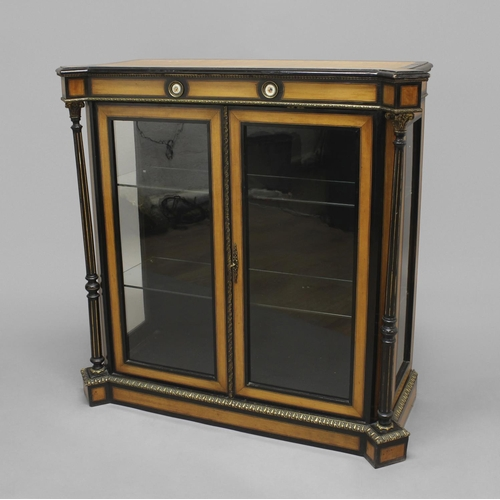 2336 - A FRENCH SATINWOOD AND EBONISED PIER CABINET, 19th century, the shaped rectangular top above a friez...