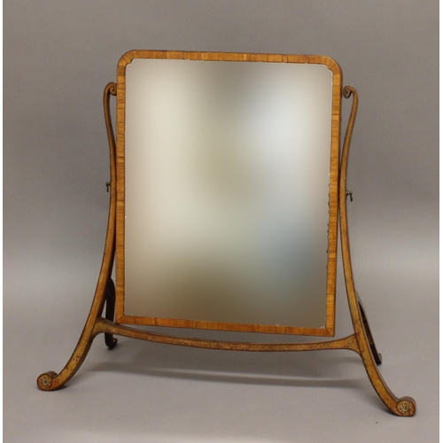 2337 - A GEORGE III SKELETON FRAMED DRESSING TABLE MIRROR. A dressing table mirror with a rectangular plate...