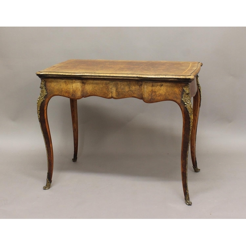 2350 - A 19TH CENTURY FRENCH WALNUT CARD OR GAMES TABLE, the shaped rectangular fold-out and swivel top abo...