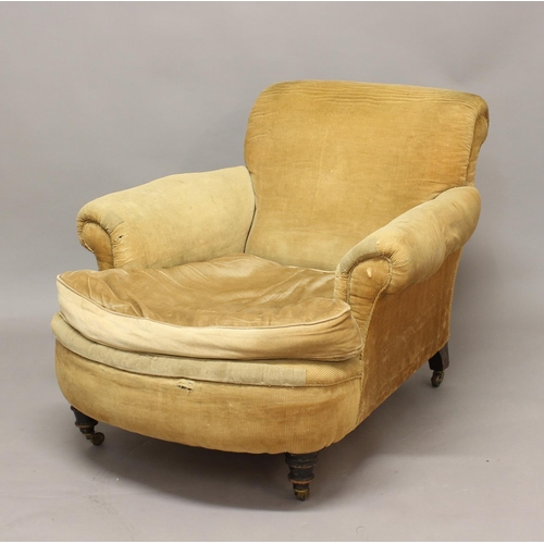 2353 - A VICTORIAN 'HOWARD' STYLE ARMCHAIR, with slightly scrolling back and arms and a deep seat on turned...