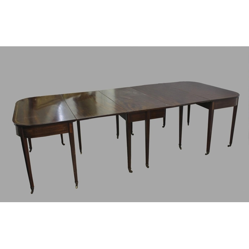 2358 - A GEORGE III MAHOGANY EXTENDING DINING TABLE, of rounded rectangular form, comprising a central gate...