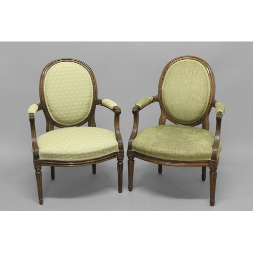 2364 - A NEAR PAIR OF FRENCH LOUIS XVI ARMCHAIRS. Two similar French Provincial armchairs with stained beec...