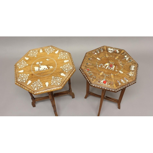 2386 - TWO INDIAN OCTAGONAL SIDE TABLES, the tops with elephant scenes inlaid in ivory, the largest 53cm hi...