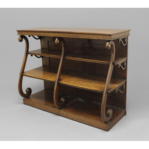 2396 - A REGENCY MAHOGANY WATERFALL BOOKCASE. With a rectangular top above three open shelves between three...