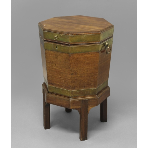 2397 - A GEORGE III BRASS BOUND MAHOGANY WINE COOLER ON STAND, of octagonal form with lead lined sectional ...