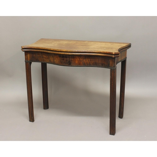 2398 - A GEORGE III MAHOGANY TEA TABLE. The serpentine fronted top with shaped sides, enclosing a polished ...