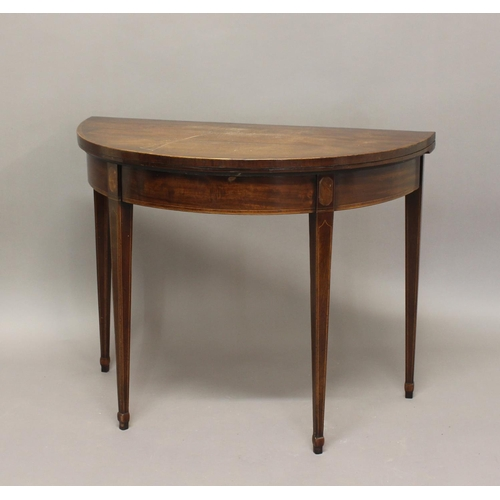 2399 - A GEORGE III MAHOGANY 'D' SHAPED CARD TABLE. The fold top with cross banded border enclosing a baize...