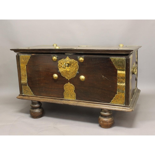 2404 - A LARGE 19TH CENTURY CEYLONESE TRUNK ON STAND. The broad rectangular top with decoratively engraved ...