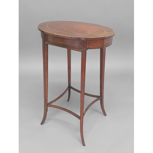 2420 - A SHERATON STYLE SATINWOOD WORK TABLE, the oval top on slender outswept legs and curved stretchers, ...