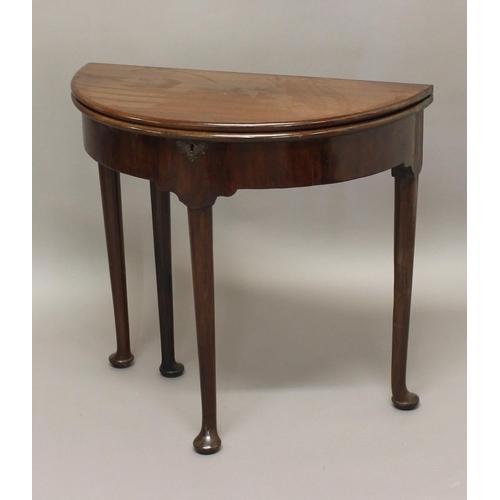 2422 - A GEORGE II MAHOGANY TEA TABLE, of demi-lune form on pad feet, height 72cm