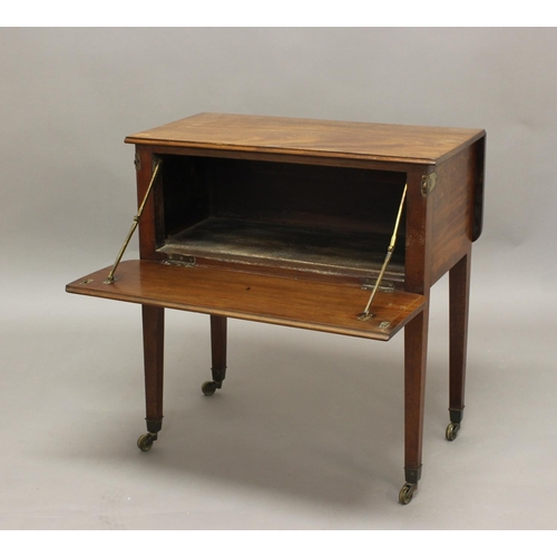 2423 - A 19TH CENTURY MAHOGANY DROP FLAP TABLE, with fall front enclosing a vacant interior, on tapering le...