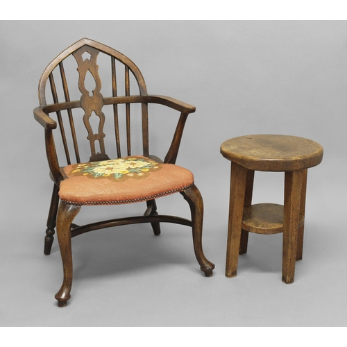 2428 - AN ASH AND ELM WINDSOR CHAIR, late 19th or early 20th century, on cabriole legs with crinoline stret...