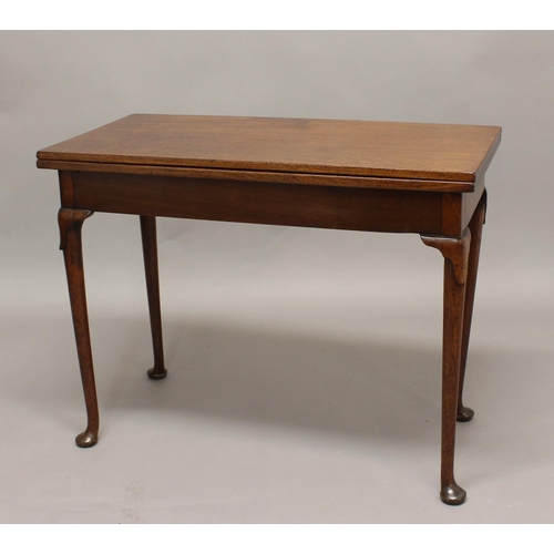 2432 - A 19TH CENTURY MAHOGANY TEA TABLE, the rectangular top on tapering legs and pad feet, height 74cm, w...