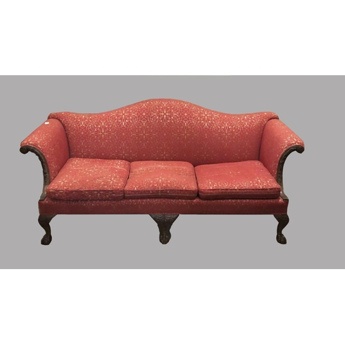 2434 - A CHIPPENDALE STYLE MAHOGANY FRAMED SETTEE. A George III style settee with an arched upholstered bac...