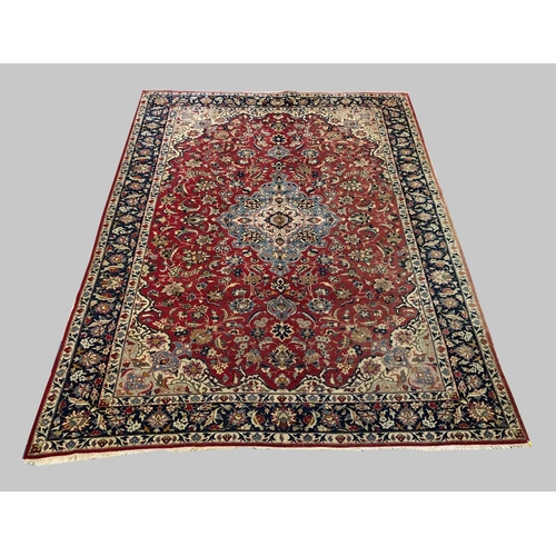 2441 - ISFAHAN CARPET, Central Iran, the crimson field of palmettes and vines centred by a sky blue and ivo...