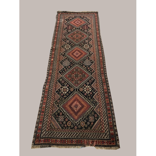 2445 - A KASHGAI RUNNER, South West Iran, c.1900, the midnight blue field with single column of latch hook ...
