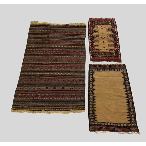 2449 - A BALOUCH KILIM, the field of polychrome bands of geometric devices, 220cm x 130cm; together with tw...