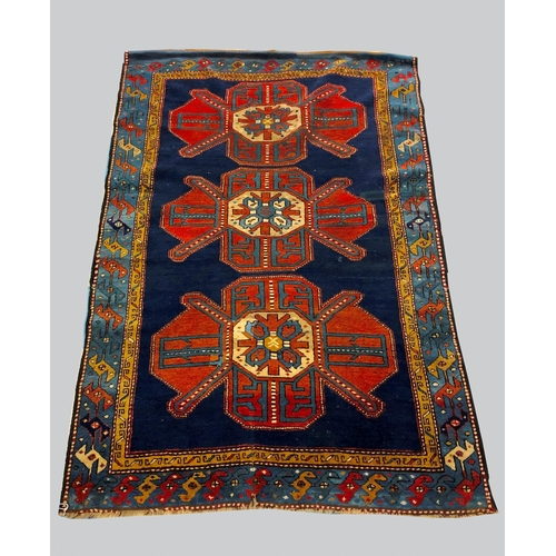 2462 - A KAZAK RUG, Central Caucasus, c.1910, the royal blue field with three madder medallions enclosed by...