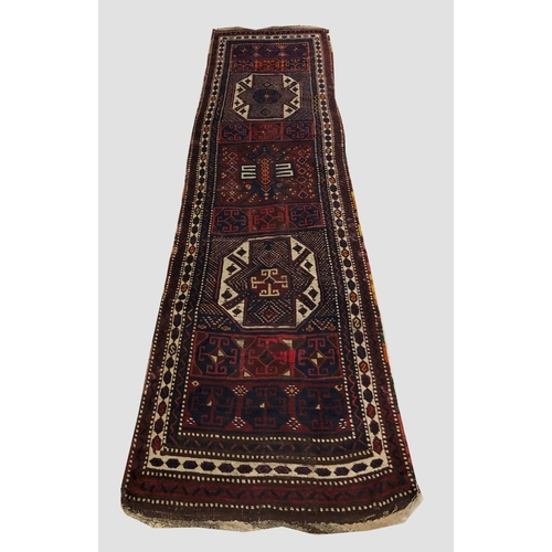 2467 - AN EAST ANATOLIAN RUNNER, c.1900, the compartmentalised field with two large octagons and interspers...
