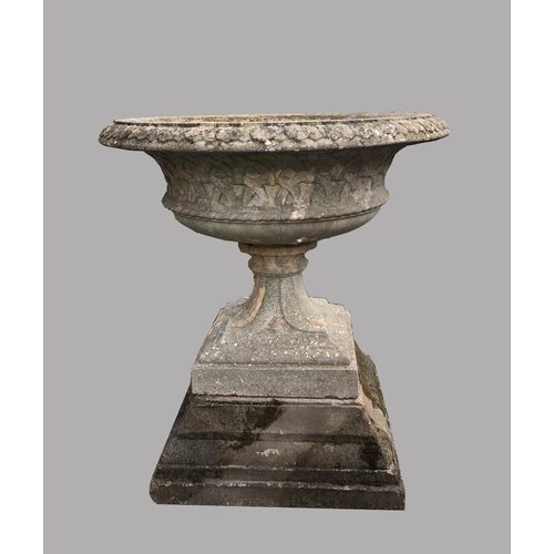 2170 - A LARGE COMPOSITION 'EASTWELL' URN ON PEDESTAL.  With a broad dished top with decorative rim and bas...