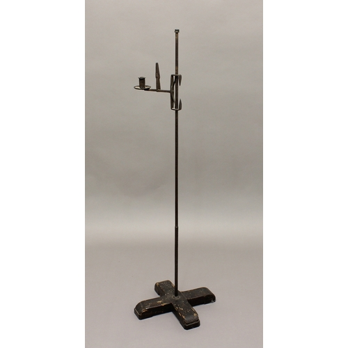 2196a - AN EARLY 18TH CENTURY RUSH LIGHT AND CANDLE HOLDER, with iron stem on a wooden 'X' base, 114cm high