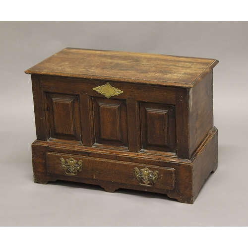 2304a - A SMALL WELSH OAK MARRIAGE CHEST, 18th century, the panelled front above single drawer, the top lift...