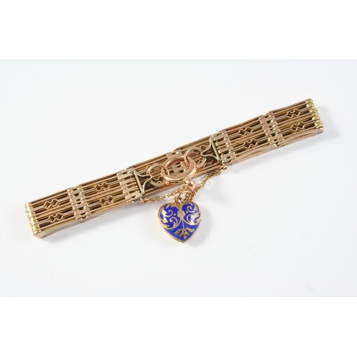 1069 - A 9CT GOLD FANCY GATE LINK BRACELET suspending a heart-shaped blue enamel charm with gold decoration...