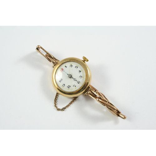 1131 - A 9CT GOLD WRISTWATCH the white enamel dial with black Arabic numerals and one red numeral at 12 o'c...