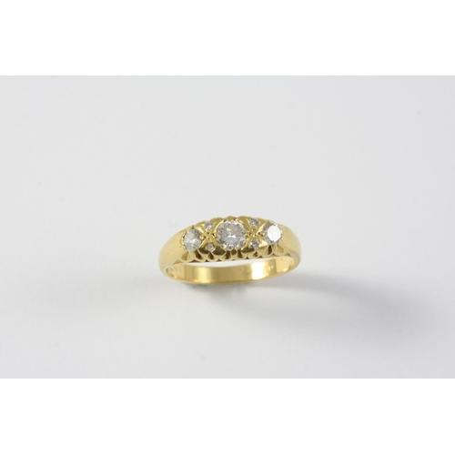 1168 - A DIAMOND THREE STONE RING the three graduated circular-cut diamonds are set with circular diamond h...