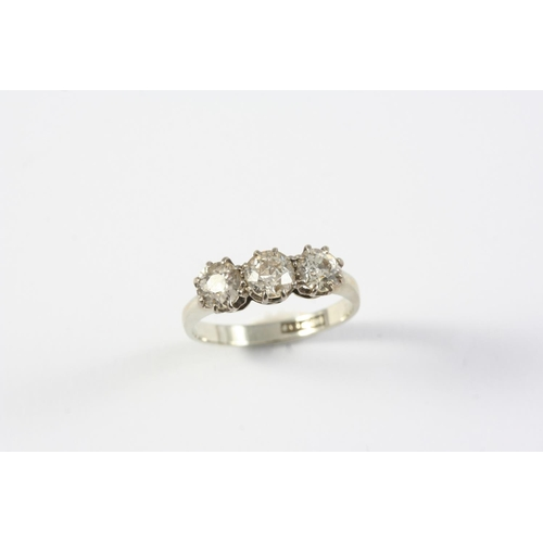 1182 - A DIAMOND THREE STONE RING set with three circular-cut diamonds in 18ct white gold and platinum. Siz...