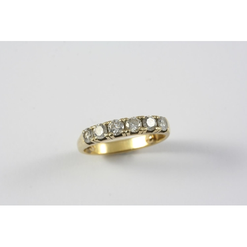 1189 - A DIAMOND HALF HOOP RING mounted with six circular-cut diamonds, in yellow gold, shank misshapen