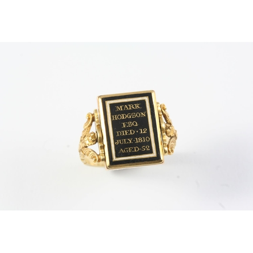 1233 - A GEORGE III GOLD AND PEARL SET SWIVEL MEMORIAL RING set to one side with a locket compartment conta...