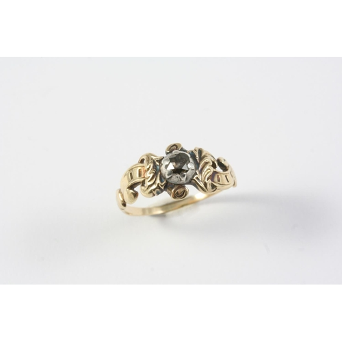 1236 - A GEORGIAN DIAMOND RING the rose-cut diamond is set in silver, with gold scrolling shoulders. Size N...