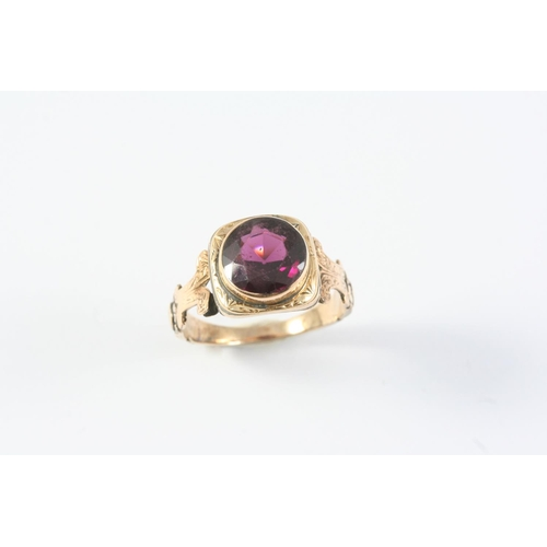 1240 - A GARNET SINGLE STONE RING the circular-cut garnet is set in a gold mount with engraved foliate deco...