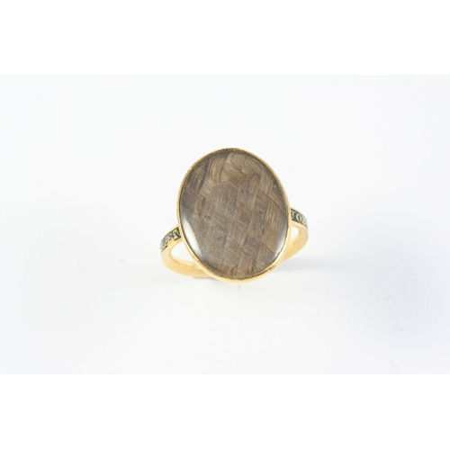 1276 - A GEORGE III GOLD AND BLACK ENAMEL MOURNING RING the centre section containing hair, with inscriptio...