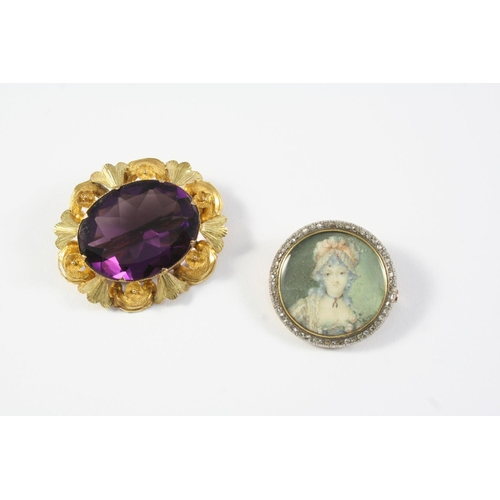 1284 - AN AMETHYST AND GOLD BROOCH the oval-shaped amethyst is set within an ornate foliate mount, 4cm wide...