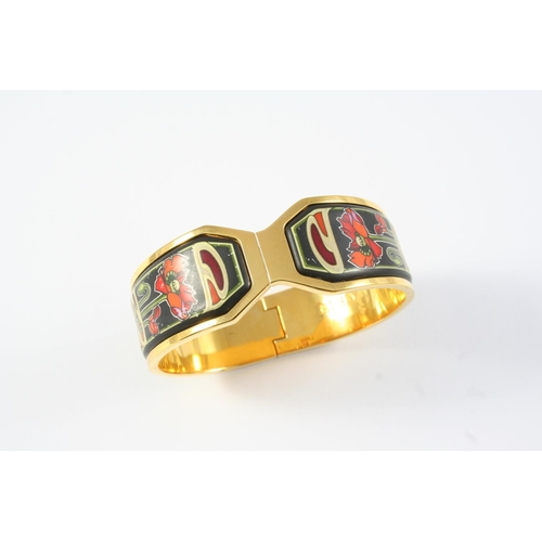 1301 - AN ENAMEL AND GOLD PLATED HALF HINGED BANGLE BY FREY WILLE decorated to one side with foliate polych...