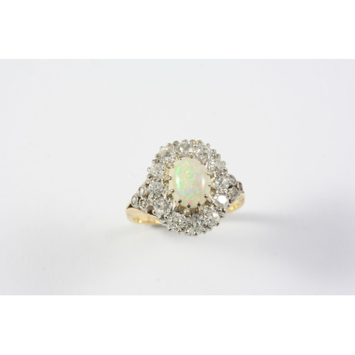 1321 - AN OPAL AND DIAMOND CLUSTER RING the oval-shaped solid white opal is set within a surround of cushio...
