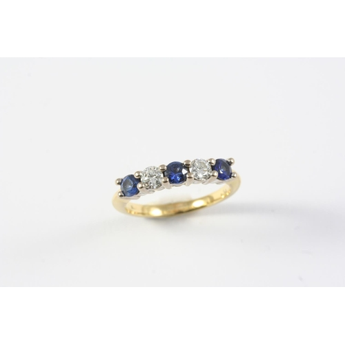 1352 - A SAPPHIRE AND DIAMOND FIVE STONE RING the three circular-cut sapphires are set with two circular-cu...