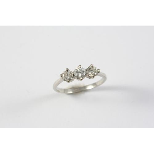1353 - A DIAMOND THREE STONE RING set with three circular-cut diamonds, in platinum. Size L