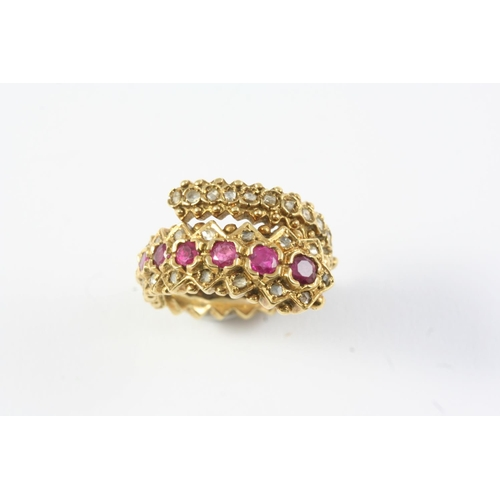 1357 - A RUBY AND DIAMOND CROSS-OVER RING BY LALAOUNIS  set with seven graduated rubies and overall with ro...