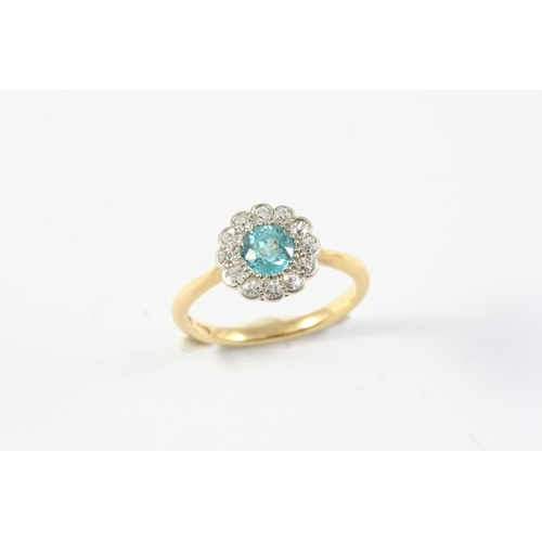 1392 - A ZIRCON AND DIAMOND CLUSTER RING the circular-cut zircon is set within a surround of circular-cut d...