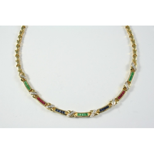 1410 - A RUBY, EMERALD, SAPPHIRE, DIAMOND AND GOLD NECKLACE the gold necklace formed with alternate polishe...