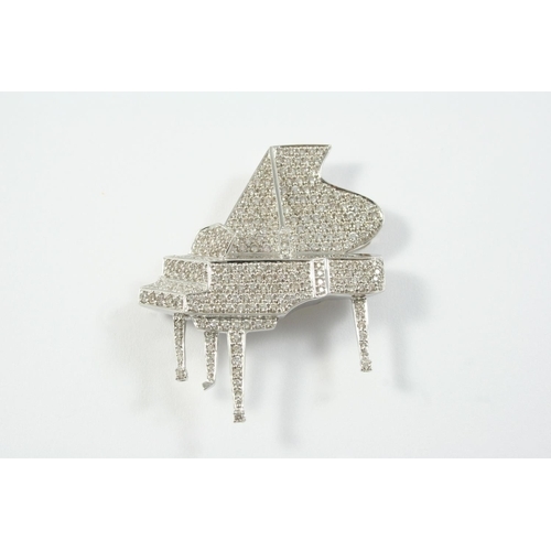 1417 - A DIAMOND GRAND PIANO BROOCH set overall with circular-cut diamonds, in 18ct white gold, 4cm wide...
