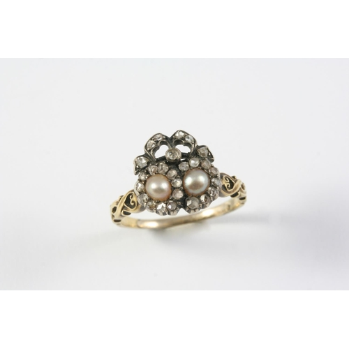 1440 - A VICTORIAN DIAMOND AND PEARL DOUBLE HEART RING mounted with two half pearls within a surround of ro...