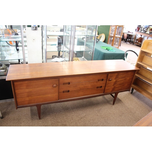 1525 - YOUNGER - TEAK MID CENTURY SIDEBOARD a large teak sideboard with three central drawers (one for cutl...