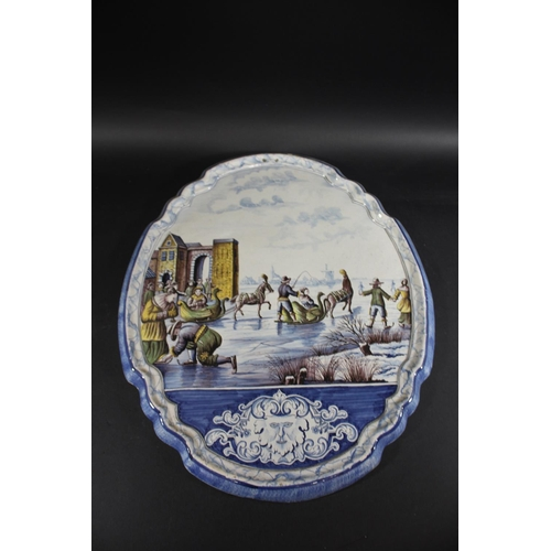 1670 - LARGE DUTCH DELFT PLAQUE a large 19thc pottery plaque, brightly painted with a frozen lake scene inc...