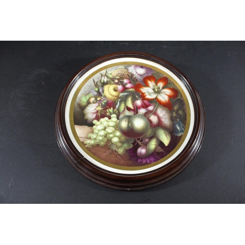 1676 - 19THC PORCELAIN PLAQUE possibly by Derby, the circular concave plaque painted with a variety of flow...
